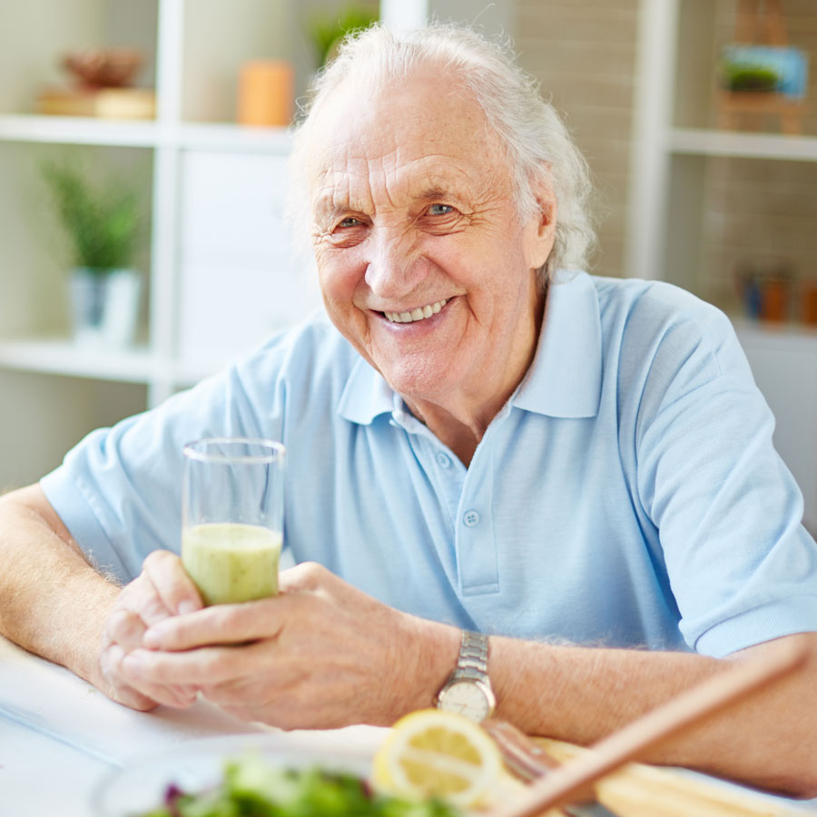 senior citizen holding a healthy drink